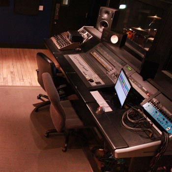 studio a control room with live room drums